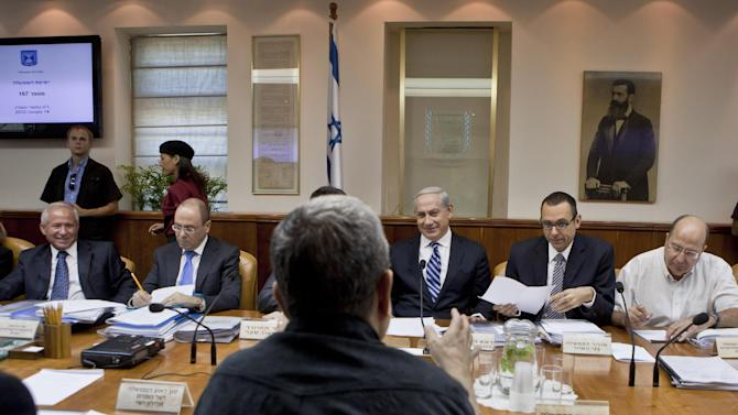 Israeli Prime Minister Benjamin Netanyahu, third right, laughs as Defense Minister Ehud Barak, back to camera, makes a joke that Netanyahu should give fair time to the opposition in political statements, as Netanyahu chairs the weekly cabinet meeting in his Jerusalem offices, Sunday, Oct. 14, 2012. Israel's Cabinet announced January 22, 2013 as the date for parliamentary elections, with Prime Minister Benjamin Netanyahu leading in the polls. (AP Photo/Jim Hollander, Pool)