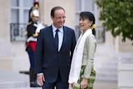 <p>Myanmar pro-democracy leader Aung San Suu Kyi is welcomed by French President Francois Hollande at the Elysee presidential Palace in Paris, as part of her historic European tour.</p>