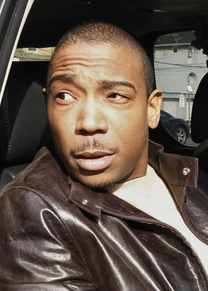 FILE - In this March 22, 2011 file photo, Rapper Ja Rule, left, is shown outside Martin Luther King, Jr. Courthouse after pleading guilty to federal tax evasion charges in Newark, N.J.   Ja Rule has been getting advice behind bars from two once high-powered men: ex-New York State Comptroller Alan Hevesi and ex-Tyco International CEO Dennis Kozlowski. The rapper's real name is Jeffrey Atkins. He's serving two years for gun possession at Mid-State Correctional Facility in Oneida, N.Y  (AP Photo/Julio Cortez, file)