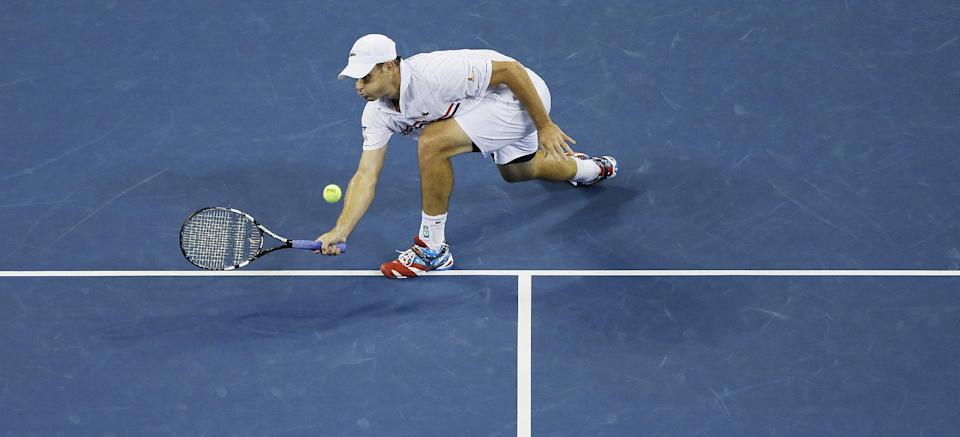 Andy Roddick returns a shot to Argentina's Juan Martin Del Potro in the fourth round of play at the 2012 US Open tennis tournament,  Tuesday, Sept. 4, 2012, in New York. (AP Photo/Darron Cummings)