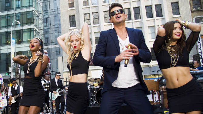 """FILE - This July 30, 2013 file photo shows Robin Thicke performing on NBC's """"Today"""" show in New York. An attorney for Thicke and collaborator Pharrell Williams filed a lawsuit Thursday, Aug. 16, 2013, in Los Angeles, asking a federal judge to determine that the pair's hit song """"Blurred Lines"""" does not copy elements from two older songs by Marvin Gaye and George Clinton. (Photo by Charles Sykes/Invision/AP, File)"""