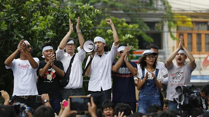 "In this June 24, 2015 photo, student activists gather outside Pathumwan Police Station in Bangkok, Thailand. Fourteen detained student activists went before a military court in Thailand on Tuesday, July 7, 2015 in a case that has attracted international calls for their release and criticism of the military junta's strict controls on freedom of speech and assembly. The university students were arrested June 26 on charges of sedition and violating the junta's ban on political gatherings for leading a peaceful anti-coup rally in Bangkok. Their head bands read ""return the power."" (AP Photo/Sakchai Lalit)"