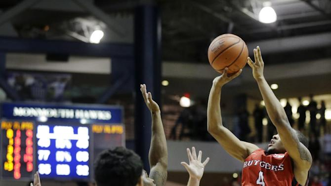 Rutgers' Myles Mack (4) takes a last second shot over Monmouth defenders to win an NCAA college basketball game Sunday, Dec. 28, 2014, in West Long Branch, N.J. Rutgers won 59-58. (AP Photo/Mel Evans)