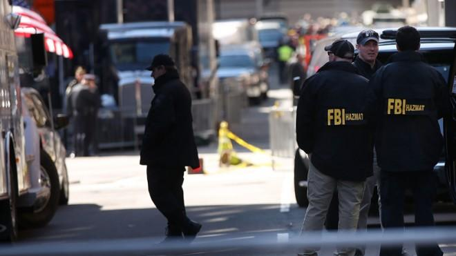 FBI agents stand near the scene of the attacks in Boston, April 16.