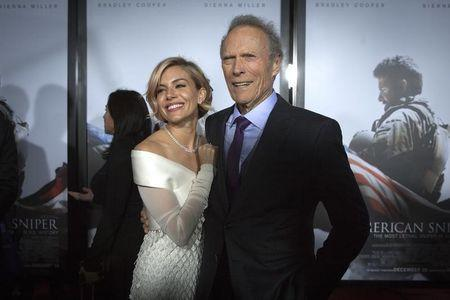 "Actress Sienna Miller and director Clint Eastwood arrive for the premiere of the film ""American Sniper"" in New York"