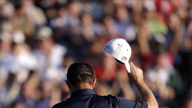 Justin Rose, of England, reacts after a putt on the 18th hole during the fourth round of the U.S. Open golf tournament at Merion Golf Club, Sunday, June 16, 2013, in Ardmore, Pa. (AP Photo/Darron Cummings)
