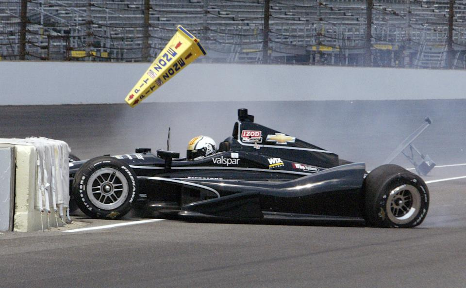 IndyCar driver Oriol Servia, of Spain, hits the wall at the entrance to the pit area on a qualification attempt during the first day of qualifications for the Indianapolis 500 auto race at the Indianapolis Motor Speedway in Indianapolis, Saturday, May 19, 2012. (AP Photo/Marc Matheny)