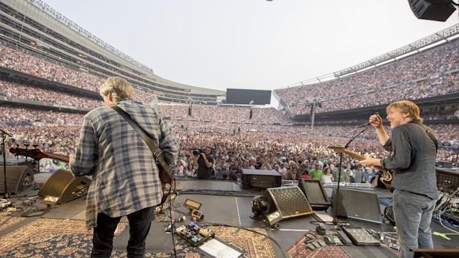 IMAGE DISTRIBUTED FOR THE GRATEFUL DEAD - Phil Lesh, Trey Anastasio of The Grateful Dead perform at Grateful Dead Fare Thee Well Show at Soldier Field on Sunday, July 5, 2015, in Chicago, Ill. (Photo by Jay Blakesberg/Invision for the Grateful Dead/AP Images)