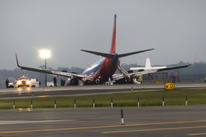 A southwest airlines plane rests on the tarmac after…