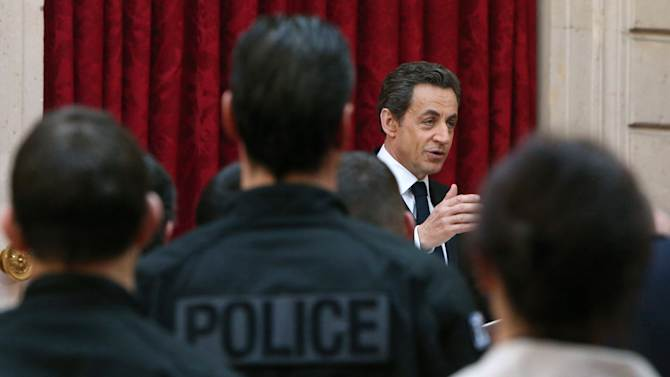 French President Nicolas Sarkozy delivers a speech to magistrates and policemen who took part in the investigations in the shooting of seven persons and the siege of the gunman Mohamed Merah in Toulouse, at the Elysee palace in Paris, Tuesday, March, 27, 2012.  Al-Jazeera has received video footage that appears to show the deadly attacks on soldiers and a Jewish school in southwestern France, including the cries of the victims and the voice of the perpetrator. French President Nicolas Sarkozy said it should not be broadcast.(AP Photo/Kenzo Tribouillard, Pool)