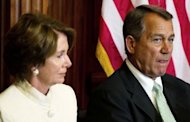 "US Speaker of the House John Boehner (R) and House Minority Leader Nancy Pelosi (L) attend an event on Capitol Hill as the House of Representatives meets to consider the ""Repeal of Obamacare Act"" in Washington. US lawmakers voted Wednesday to repeal the law, a contentious move by Republicans aimed at striking down one of Obama's key achievements in an election year"