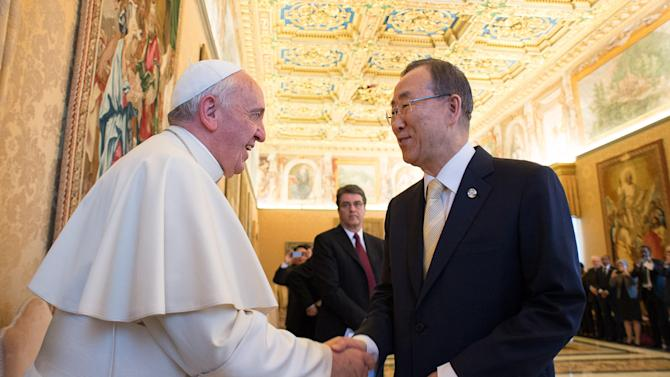 """In this photo provided by the Vatican newspaper L'Osservatore Romano, Pope Francis greets U.N. Secretary-General Ban Ki-moon at the Vatican, Friday, May 9, 2014. Pope Francis called Friday for governments to redistribute wealth to the poor in a new spirit of generosity to help curb the """"economy of exclusion"""" that is taking hold today. Francis made the appeal during a speech to U.N. Secretary-General Ban Ki-moon and the heads of major U.N. agencies who are meeting in Rome this week. Latin America's first pope has frequently lashed out at the injustices of capitalism and the global economic system that excludes so much of humanity. (AP Photo/L'Osservatore Romano)"""