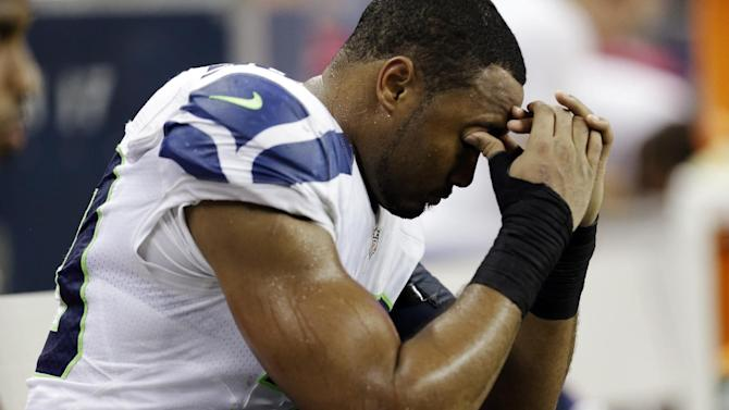 Seattle Seahawks outside linebacker K.J. Wright (50) looks down near the end of an NFL football game against the Detroit Lions, Sunday, Oct. 28, 2012. in Detroit. The Lions won 28-24. (AP Photo/Paul Sancya )