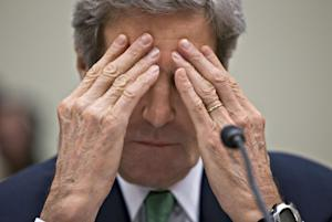 Secretary of State John Kerry rubs his eyes while …