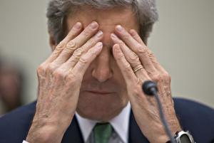 Secretary of State John Kerry rubs his eyes while…