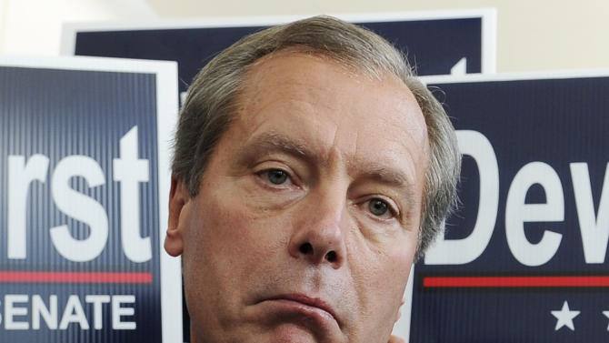 Texas Lt. Gov. David Dewhurst is backed by supporters outside a Houston deli as he ponders a reporters' question Tuesday, July 31, 2012. Dewhurst faces former Texas Solicitor General Ted Cruz in the Republican primary runoff election for U.S. Senator. (AP Photo/Pat Sullivan)