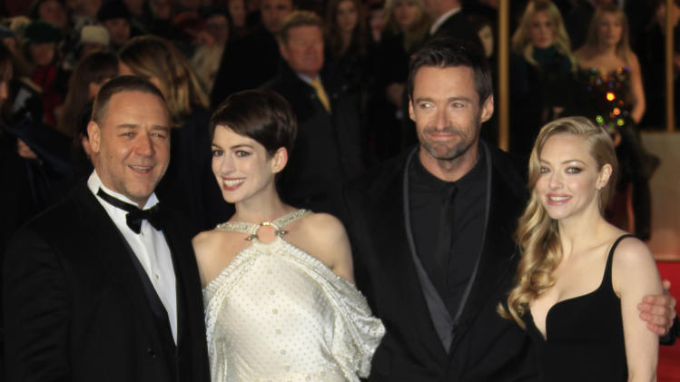 Russell Crowe, Anne Hathaway, Hugh Jackman and Amanda Seyfried arrive on the red carpet for the World Premiere of 'Les Miserables' at a central London cinema in Leicester Square, Wednesday, Dec. 5, 2012. (Photo by Joel Ryan/Invision/AP)