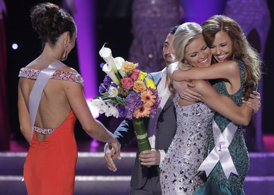 Madeline Mitchell, left, Miss Alabama, walks away as Alyssa Campanella, Miss California, right, and Miss Tennessee, Ashley Elizabeth Durham react as they are annouced as the two remaining finalists in the 2011 Miss USA pageantSunday, June 19, 2011, in Las Vegas.  (AP Photo/Julie Jacobson)