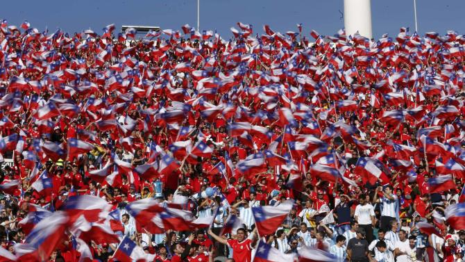 Chile fans waves Chile flags ahead of the team's Copa America 2015 final soccer match against Argentina at the National Stadium in Santiago