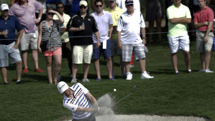Keegan Bradley hits out of a bunker onto the 15th green during the second round of the Byron Nelson Championship golf tournament on Friday, May 17, 2013, in Irving, Texas. (AP Photo/Tony Gutierrez)