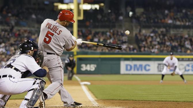 Los Angeles Angels' Albert Pujols (5) connects for a three-run home run during the sixth inning of a baseball game against the Detroit Tigers in Detroit, Friday, April 18, 2014. (AP Photo/Carlos Osorio)