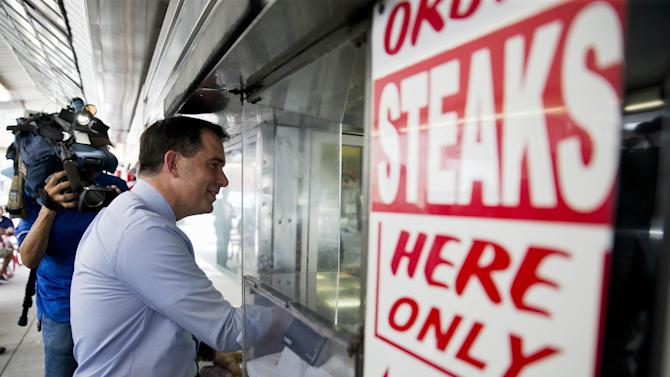 Republican presidential candidate, Wisconsin Gov. Scott Walker, places an order for a cheesesteak Tuesday, July 28, 2015, during a campaign stop at Pat's King of Steaks in Philadelphia. (AP Photo/Matt Rourke)