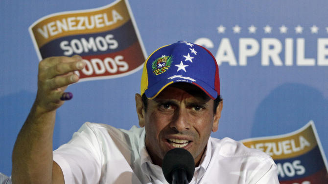 Opposition presidential candidate Henrique Capriles talks to journalists in Caracas, Venezuela, Monday, April 15, 2013. Venezuela's government-friendly electoral council indicated Monday it would quickly certify the presidential victory of Hugo Chavez' hand-picked successor Nicolas Maduro, apparently ignoring opposition demands for a recount in Sunday's tight race. (AP Photo/Fernando Llano)