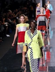 Models present creations by Issey Miyake during the Spring/Summer 2013 ready-to-wear collection show in Paris