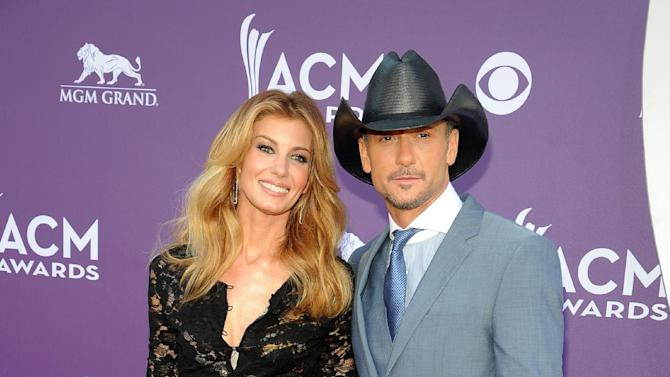 Singers Faith Hill, left, and Tim McGraw arrive at the 48th Annual Academy of Country Music Awards at the MGM Grand Garden Arena in Las Vegas on Sunday, April 7, 2013. (Photo by Al Powers/Invision/AP)