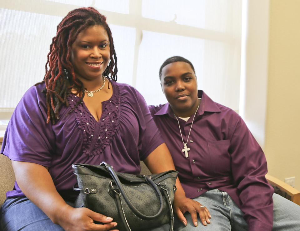Rika Grier, left, and her partner Pastor Nicki Fairley, wait at the San Diego County marriage bureau while obtaining their license in San Diego, Monday, July 1, 2013. The pair have been together for six years. (AP Photo/Lenny Ignelzi)