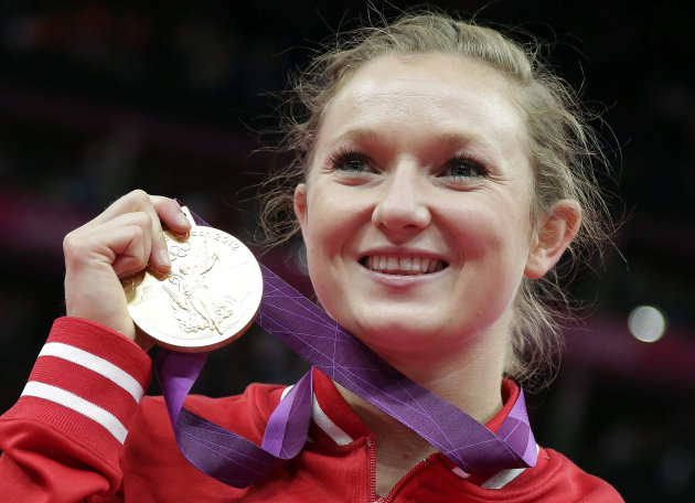 Canada's Rosannagh Maclennan displays her gold medal during the podium ceremony of the women's trampoline at the 2012 Summer Olympics, Saturday, Aug. 4, 2012, in London. (AP Photo/Gregory Bull)