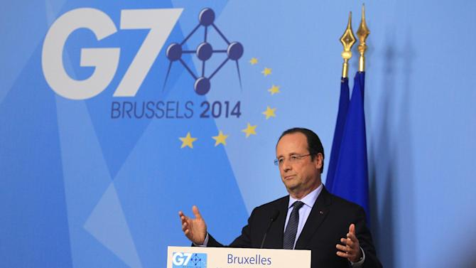 French President Francois Hollande addresses the media during a G7 summit at the European Council building in Brussels, Wednesday June 4, 2014. The leaders of the G7 will deliberate their next steps in response to the enduring unrest in Ukraine, after sidelining Russia for its role in the crisis. (AP Photo/Yves Logghe)