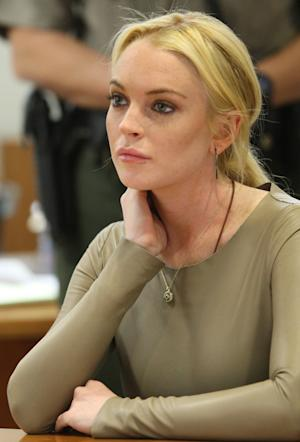 Lindsay Lohan appears at Los Angeles Superior Court, Thursday, March 10, 2011. Lohan rejected a plea agreement Thursday offered by prosecutors in a grand theft case that included a guaranteed return to jail. She told a judge she agreed to delaying her case until a preliminary hearing when prosecutors will present evidence against her. Lohan is accused of taking a $2,500 necklace from a Venice jewelry store. (AP Photo/David McNew, pool)