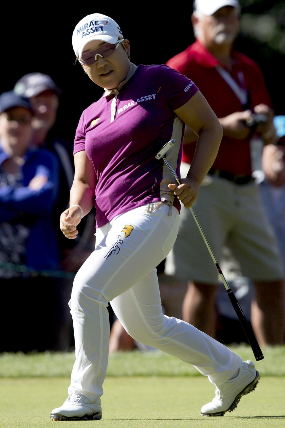 Jiyai Shin, of South Korea, celebrates after making par on the third hole during the final round of the LPGA Tour's Canadian Women's Open golf tournament, Sunday, Aug. 26, 2012, at the Vancouver Golf Club in Coquitlam, British Columbia. (AP Photo/The Canadian Press, Darryl Dyck)