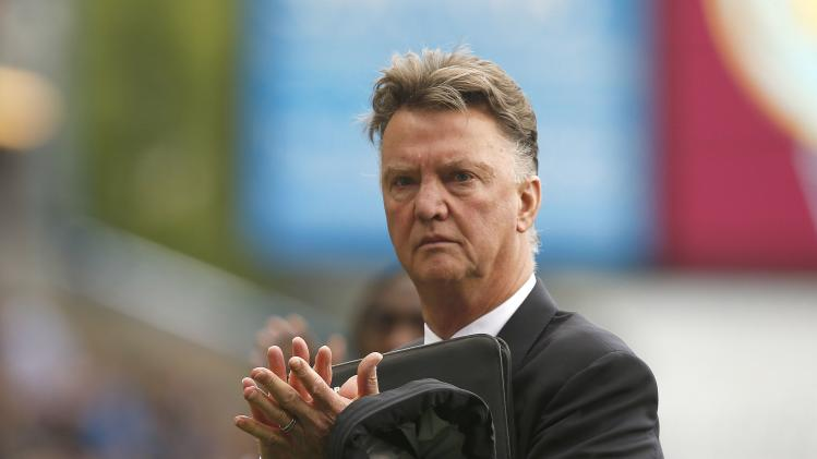 Manchester United manager Van Gaal applauds the fans as he leaves the pitch following their English Premier League soccer match against Burnley at Turf Moor in Burnley