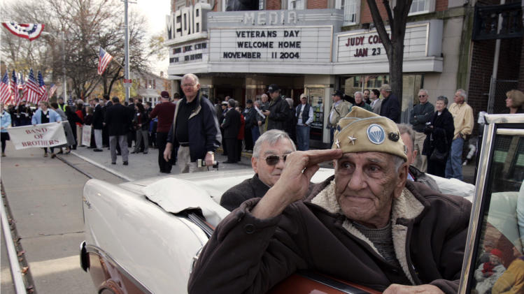 "CORRECTS DAY DIED TO SATURDAY MARCH 8, 2014  FILE - This Nov. 11, 2004 file photo shows William ""Wild Bill"" Guarnere participating in the Veterans Day parade in Media, Pa. Guarnere, one of the World War II veterans whose exploits were dramatized in the TV miniseries ""Band of Brothers,"" has died, Saturday, March 8, 2014, at the age of 90.  (AP Photo/Jacqueline Larma, file)"