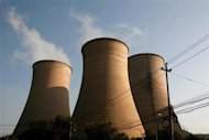 Cooling towers at a thermal power plant are pictured near Pingguoyuan in Beijing City, October 5, 2010. REUTERS/Joel Boh