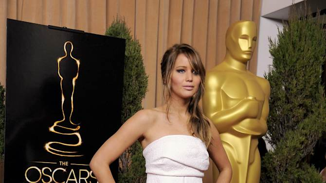 """Jennifer Lawrence, nominated for best actress in a leading role for """"Silver Linings Playbook,"""" arrives at the 85th Academy Awards Nominees Luncheon at the Beverly Hilton Hotel on Monday, Feb. 4, 2013, in Beverly Hills, Calif. (Photo by Chris Pizzello/Invision/AP)"""