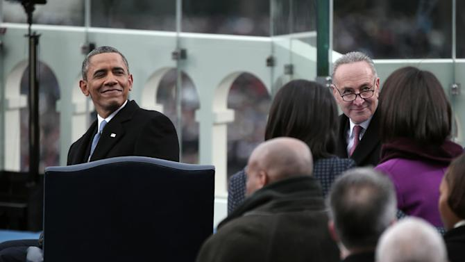President Barack Obama and Sen. Charles Schumer, D-N.Y., chairman of the Joint Congressional Committee on Inaugural Ceremonies, look behind them on the West Front of the Capitol in Washington, Monday, Jan. 21, 2013, during the presidential ceremonial swearing-in ceremony during the 57th Presidential Inauguration.  (AP Photo/Win McNamee, Pool)