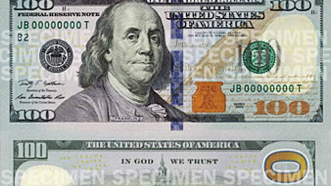 This undated image provided by FBI shows the newly designed $100 bill.  The FBI is reporting an unusual heist of some of the bills, which aren't going into circulation until next year. Agent Frank Burton Jr. says the cash was stolen from a plane that arrived at Philadelphia International Airport around 10:25 a.m. Thursday, Oct. 11, 2012, from Dallas. (AP Photo/FBI)