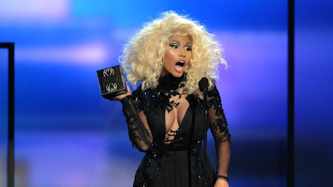 Nicki Minaj accepts the award for favorite artist - rap/hip-hop at the 40th Anniversary American Music Awards on Sunday, Nov. 18, 2012, in Los Angeles. (Photo by John Shearer/Invision/AP)