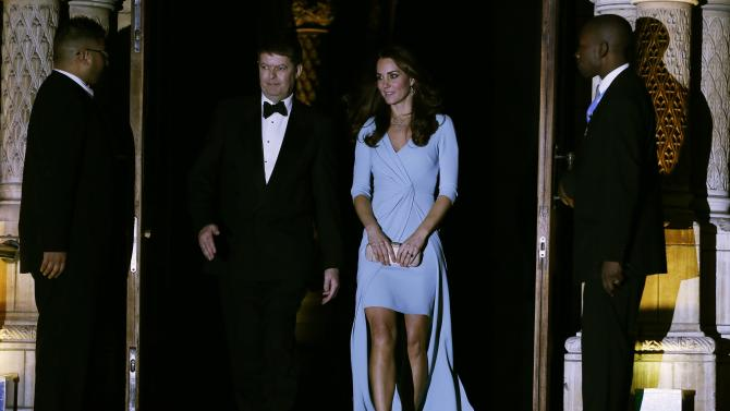Britain's Catherine, Duchess of Cambridge speaks with museum director Dixon as they leave the Natural History Museum in London