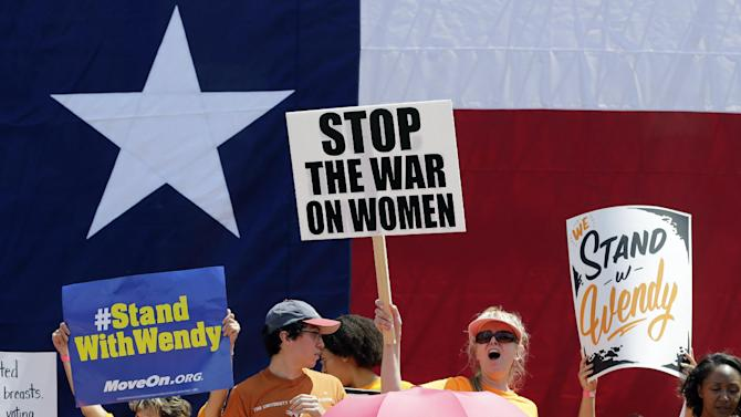 Pro-abortion rights supporters cheer during a rally outside the Texas capitol, Monday, July 1, 2013, in Austin, Texas. The Texas Senate has convened for a new 30-day special session to take up contentious abortion restrictions bill and other issues. (AP Photo/Eric Gay)