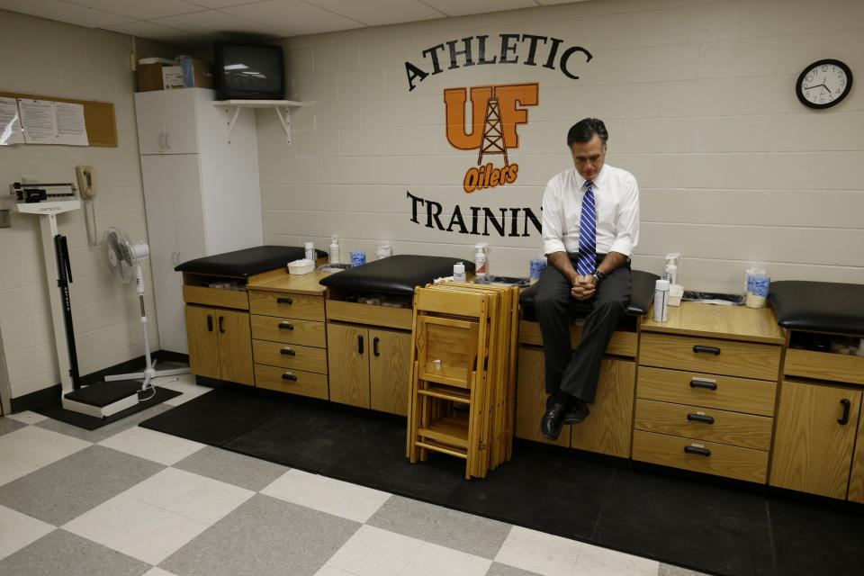 Republican presidential candidate and former Massachusetts Gov. Mitt Romney sits in a training room to gather his thoughts before the start of a campaign rally at Koehler Athletic Complex, University of Findlay, Sunday, Oct. 28, 2012, in Findlay, Ohio. (AP Photo/Charles Dharapak)