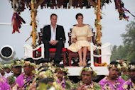 Prince William and Catherine are carried on thrones upon their arrival at Funafuti in Tuvalu on September 18. The couple flew home Wednesday after a night of feasting and dancing in Tuvalu, grateful for a ban on further publication of topless photos of the duchess