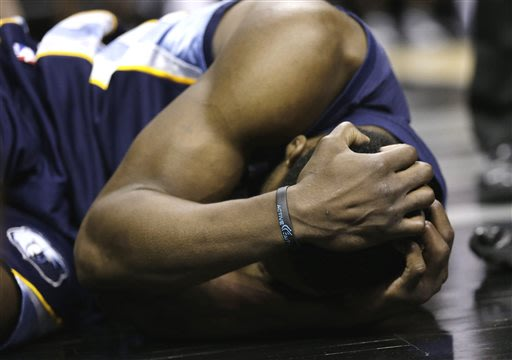 Memphis Grizzlies' Tony Allen holds his head after he was fouled by San Antonio Spurs' Manu Ginobili during the second half in Game 2 of a Western Conference Finals NBA basketball playoff series, Tues