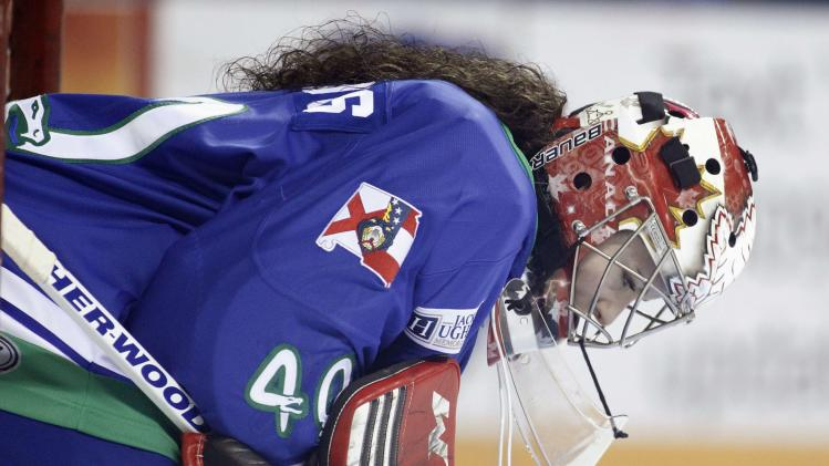 Columbus Cottonmouths goaltender Shannon Szabados reacts after a Knoxville Ice Bears score in the first period in Columbus
