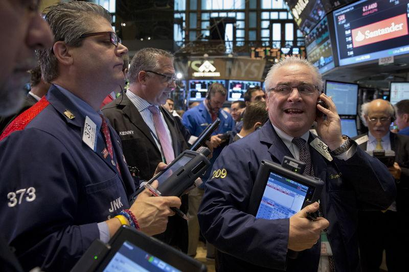 Wall Street up as near-term rate-hike prospects fade; oil jumps