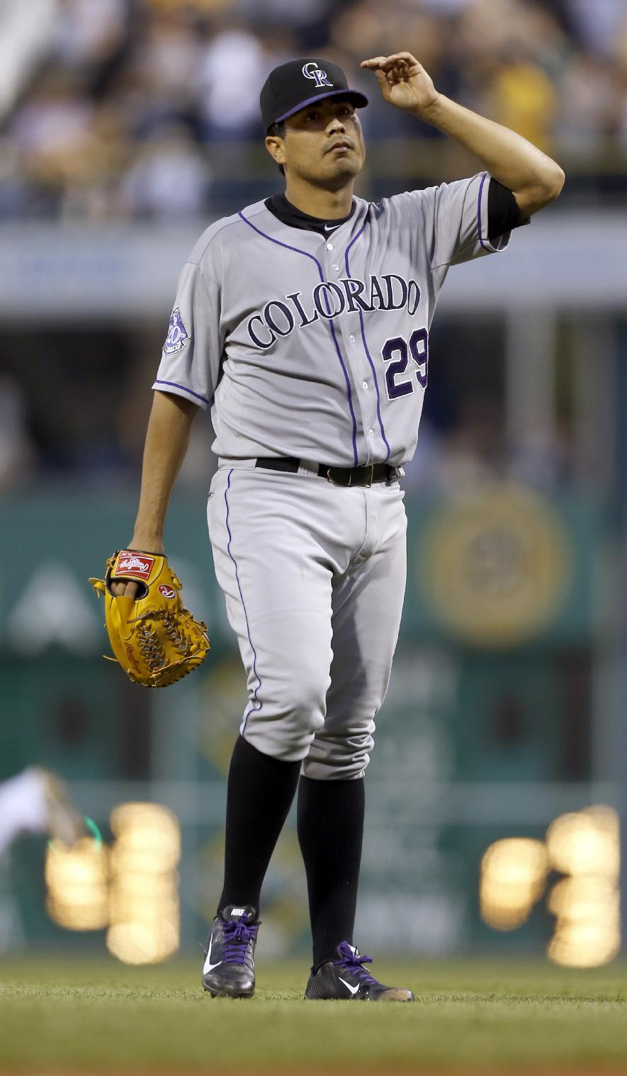 Liriano leads Pirates to 5-2 win over Rockies