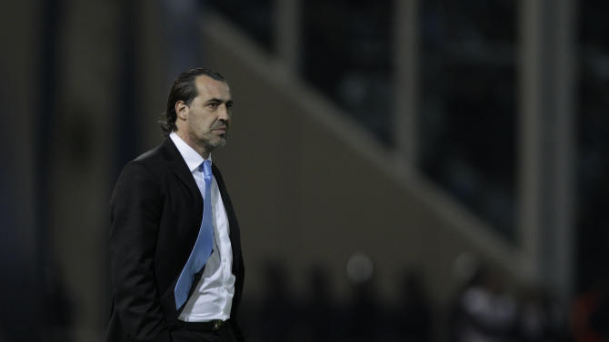 In this photo taken July 11, 2011, Argentina's coach Sergio Batista looks on during a group A Copa America soccer match against Costa Rica in Cordoba, Argentina. Batista has been dismissed as Argentina coach following the Copa America in which a team of stars led by Lionel Messi managed only one victory. (AP Photo/Felipe Dana)